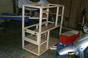 Another view of the cat cage with added door